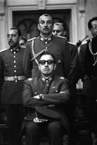 Augusto Pinochet sits with sunglasses in the front of the Chilean Junta